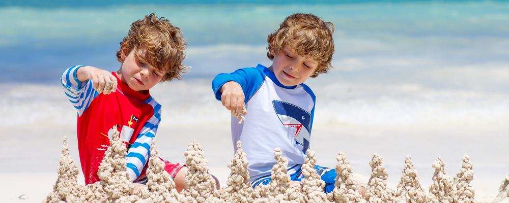 Boys building sandcastles on beach
