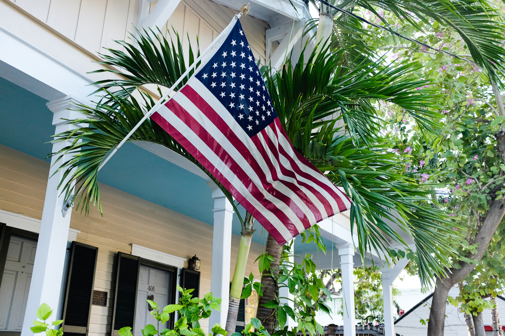 American flag attached to porch of house