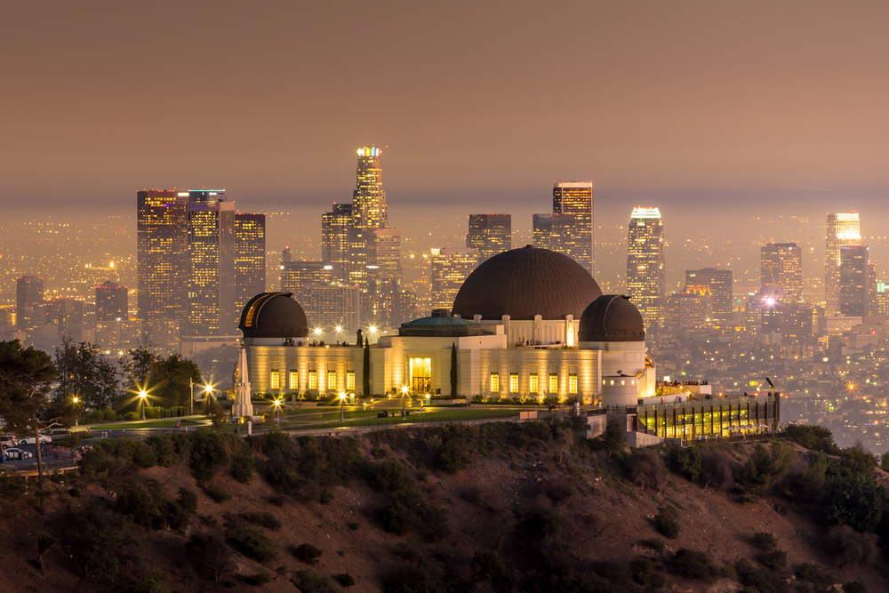 The Griffith Observatory and Los Angeles city skyline at twilight CA