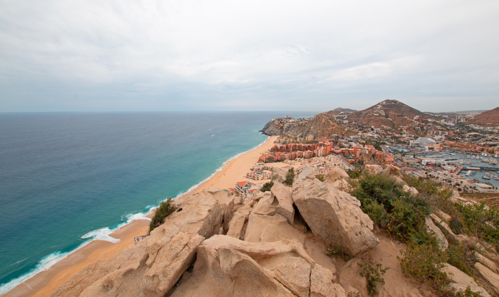 View of Pacific Ocean and Sea of Cortes and Cabo San Lucas marina as seen from the top of the Mount Solmar hiking trail in Baja California Mexico BCS